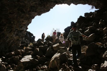 students walking into a cave