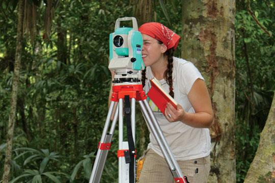 Archaeologist using a mapping station